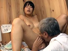 Old fart is banging a Japanese chick in the sauna