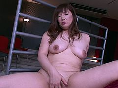 This sexy milf first starts of by rubbing a small vibrator on her clit but that is simply not enough for her. She shoves the whole vibrator in her pussy and after pulling it out she moves on to the bigger penis shaped pink vibrator. She sucks on it and rubs it against her tits.