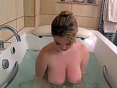 Hot lady Lyla Ashby is taking a bath and her gigantic breasts are almost floating on the surface and they look so succulent whey wet.