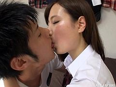 This sensual Japanese schoolgirl is going to lose her virginity today. She kisses her boyfriend, and then licks his chest. She lifts up her skirt for him so that he can rub her cunt over her cute panties.