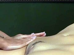 Andy San Dimas is a masseuse and Samantha Ryan a client. Andy is really attracted to Samantha. After she gets caught rubbing her pussy, Samantha kisses her and they have sex.
