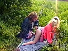 Two girls and a guy head out to the woods, strip naked and he ends up fucking both of them right there in the great outdoors.