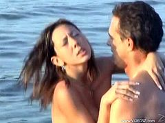 Take a look at this hardcore scene where this sexy babe is fucked on the beach by this guy after she sucks on this guy's cock.