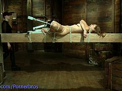 Watch an alluring brunette slave getting gagged and suspended before her pussy is vibrated into a mind-blowing orgasm.