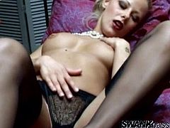 Press play to watch this blonde babe, with big boobs wearing sexy lingerie and stockings, while she touches herself in a hot solo model video.