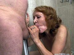 A lustful woman gives a skillful blowjob while taking a shower. Then this mature slut gets fucked in her shaved pussy by her hubby.