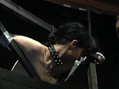 This submissive brunette gets punished by her master in many brutal ways. He spanks her, whips her and tortures her with hot wax before he fucks her mouth.