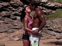 Tanned brunette Simone is having fun with a black guy on a beach. They fondle each other and have oral sex and then Simone takes the BBC in her shaved pussy and gets fucked in cowgirl position.