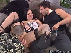 Busty long-haired brunette Renee Pornero wearing a corset and stockings is playing dirty games with two men. She gives them head and then gets sandwiched and facialed.