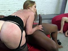 Big-breasted blonde Desiree De Luca is having a great time with a horny black dude. She drives him crazy with a passionate blowjob and then they fuck in reverse cowgirl and other positions.
