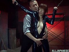 Sexy Japanese slave Mikoto Tsukawa wearing a latex overall is having fun with some man in a basement. She gets tied up and then enjoys a dildo in her pussy.