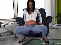 She looks really good in those tight jeans, but she looks even better, when she pisses all over them. Can you believe she actually did that? She takes off her pants, to reveal her beautiful pussy for us.