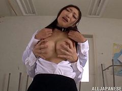 Get a load of Reiko Kobayaka's big round tits and her amazing ass in this hot scene before she gives this guy head in a classroom.