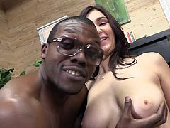 Captivating brunette Holly Michaels has just had sex with a black stud. She shows her amazing big natural boobs for the cam and wipes her belly with a napkin.