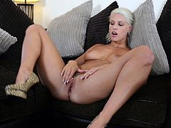 Kinky blonde Blanche Bradburry is getting naughty in a bedroom. She strips and demonstrates her amazing butt and then spreads her legs wide and pleases herself with fingering.