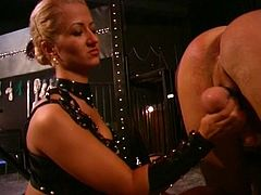 Domino lady has two slaves in a cage and she spanks their butts and gets a male slave too