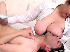 This broad has amazing big ass tits and she's gettin' them fuckin' sucked on like crazy by some motherfucker. Check it out right here!