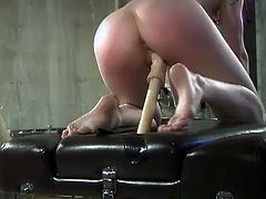 checkout this sexy femdom bitch in nurse uniform, torturing her busty sex slave. See how she forces her to suck on a huge dildo while she fingers her cunt hard and deeply.