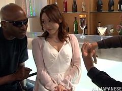 A pretty Japanese woman is playing dirty games with two handsome black studs indoors. She shows her butt to the guys and then pleases one of them with a blowjob.