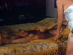 Horny MILF wearing silk nightie bends over letting her lover play with her ass hole. Kinky dude with mustaches finger fucks his woman. Check this out.