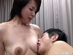 Slim short-haired Japanese milf Kumi Kanzaki is having fun with a man indoors. They fondle each other and have oral sex and then bang in missionary and other positions.