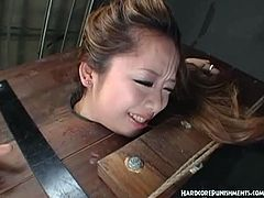 Japanese chick is ready for some rough action with her masters. She is completely helpless and they start to spank her booty and make her scream loud as hell.