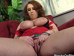 Hot redhead Felicia Clover is getting naughty indoors. She takes her bra off and demonstrates her huge natural boobs for the cam.