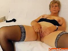 Czech Cougars brings you a hell of a free porn video where you can see how a mature blonde in stockings dildos her sweet cunt into heaven while assuming very hot poses.