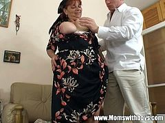 An horny granny is ready to get hammered by a horny dude. He shows no mercy and sticks this schlong deep her fat cunt to make her scream like never before.