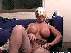 Get a hard dick watching this blonde cougar, with giant jugs wearing nylon stockings, while she rubs her clit in a backstage video.