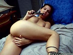 Pretty brunette Eve Angel wearing lingerie is having fun indoors. She strokes her nice tits and pussy and then pokes a toy into her pink slit.