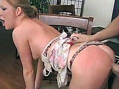She gets bent over a table and slammed hard from behind then lets him pull out and fire his sticky load all over her pretty face.