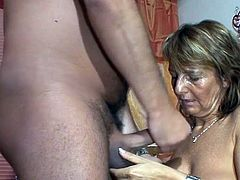 She barely holds herself from screaming while having this large cock pounding her very fast and deep