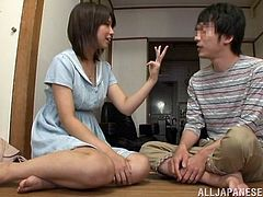 Have fun watching this Asian girl, with a hairy pussy wearing a cute sky-blue dress, while she uses her hands wisely with a horny fellow.