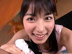 Beautiful Japanese hottie sucks on a hard cock