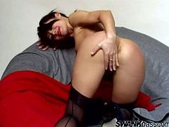 Amazing brunette Ines wearing thong and stockings demonstrates her hot ass for the cam. Then she sits down in an arm chair and pleases herself with fingering.