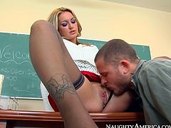 Horny brutal fellow attacked sweet pussy of that bosomy gorgeous blondie right on desk in classroom. He licked that tasty kitty hard. Just watch that hot cunnilingus in Naughty America sex video!