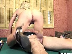 Kasey Grant is an older slut who plays fuck games. She ends up with her snatch full of hot sticky cum. They have a really great time fucking on that pool table!