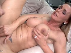 Here we can see Tanya Tate, who is by the way one of the hottest milf in the business, riding cock while her titties bounce. Nice to see a video ends with cum on huge titties.
