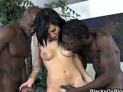 Muscled dark men with equally strong dicks ramming inside her shaved pussy while she moans in pleasure is the best interracial group sex she ever had!