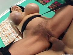 Kinky black haired mommy can't handle her giant silicon boobs. Her plastic melons jiggle up and down while she rides big dick in reverse cowgirl pose. Then dude brutally fucks her wet hairy cunt on her side from behind.