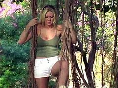 A smoking hot chick is at the park and she is in the mood for some naughtiness. The sexy blonde displays her boobs and enjoys making accidental passengers horny.