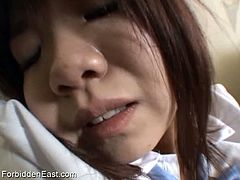 Forbidden East brings you a hell of a free porn video where you can see how this kinky Japanese brunette babe in a schoolgirl uniform masturbates while assuming very sexy poses.