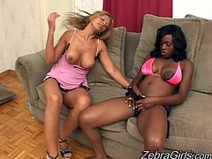 Busty ebony siren is fucking that horny one with a strapon