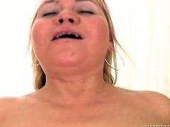 Chubby blonde mom with big saggy boobs and belly worships huge black dick sucking it in sloppy way. Busty mom rides that black hose in reverse cowgirl pose and gets screwed on her side from behind.