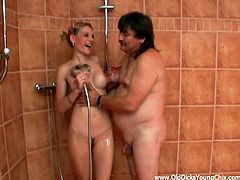 Have a look at this hot scene where this naughty blonde teen sucks on this old man's thick cock in the shower after he eats her shaved pussy out.