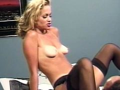 Blondie in black stockings and with perky tits opens her legs for a fat cock to smack her creamy vag