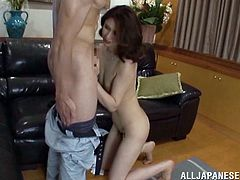 A Japanese MILF takes off clothes and gets her vagina fingered. Then this Asian cougar gives a blowjob and gets nailed hard on a sofa.