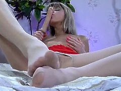 Nylon Feet Line brings you a hell of a free porn video where you can see how the hot blonde Gina Gerson dildos her tight pink cunt afterr giving the toy a great footjob.