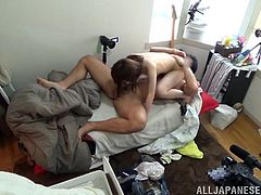 A terrible weather makes Japanese chick go with a stranger to his house. They fondle each other and fuck in the missionary and cowgirl positions.
